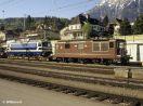 BLS Re 4/4 169 vor einem Güterzug in Spiez